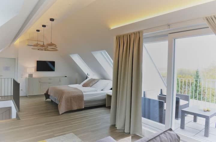 Maisonettewohnung mit Balkon und Stadtblick