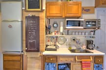 We have packed this kitchen with toaster oven, micro wave, induction plate, refrigerator, and more.
