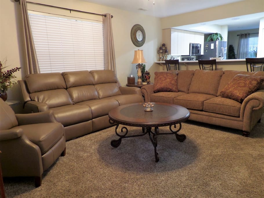 Living Area - Recliner, Reclining Sofa, and Queen Sofa Sleeper (All New)