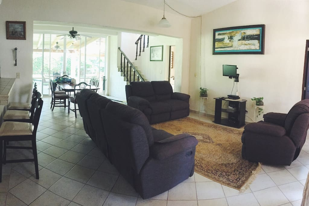 Wide angle view of dining area and living room