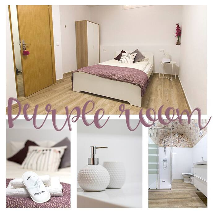 Stylish purple room with ensuite bathroom and window