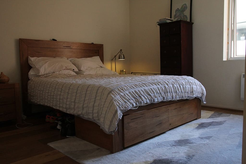 Bedroom with queen size bed and lots of natural light.