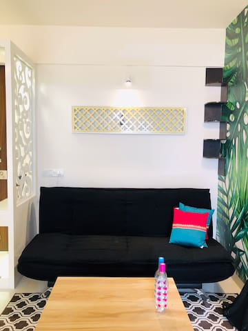 living area with designer lights and modern setup