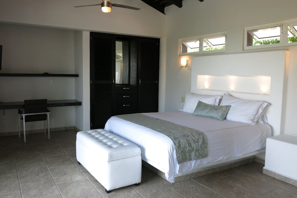 Brand new bedroom with top quality king size bed, upscale white linen, computer work station, wifi, shaw satellite