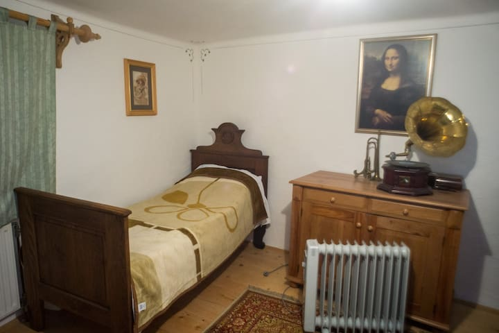 Second bedroom with vintage furniture