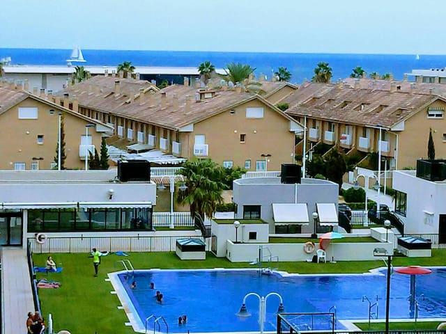 Beach apartment, sea views, pool, gated complex.