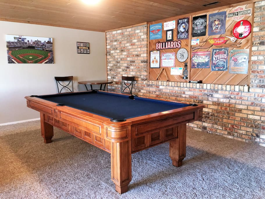 Enjoy playing billiards in the game room.