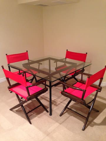 Dining table with 4 chairs. Note: no cooking facilities - just a small fridge and a microwave - but plenty of great options for food just steps away (something for everyone's taste and budget).