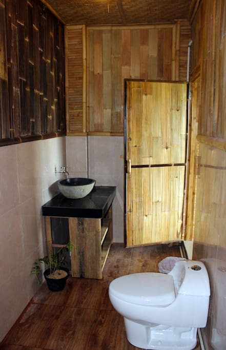 Enjoy the ensuite bathroom with hot water and amenities provided