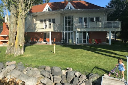 Apartments with large private beach - Siófok