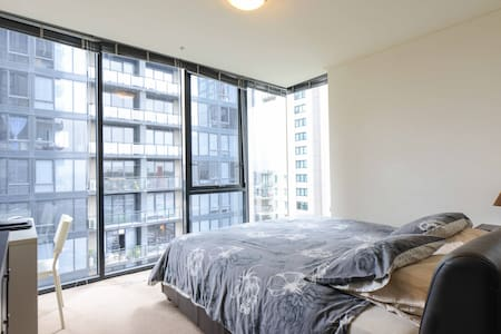 Master bedroom & en suite bath w/ pool, gym, etc. - Southbank - Apartment