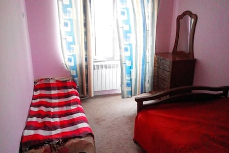 Уютная комната с спальней