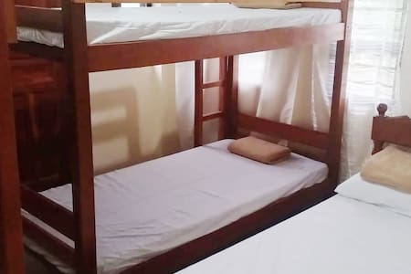 Marjorie Homestay - Bedroom 1 with AC & Private CR