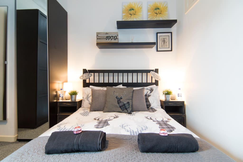 Rest your head in the comfortable double bed with ample pillows, cushions, and blanket.
