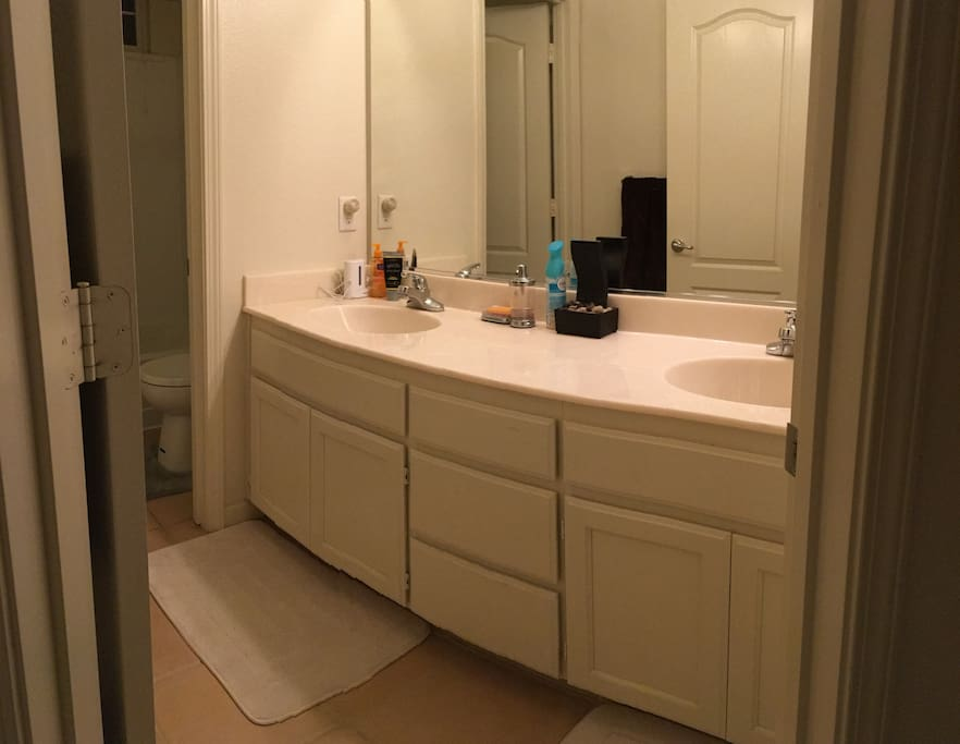 Upstairs shared batheroom. His/Her Sinks.