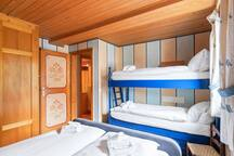The 2° Bedroom with double bed joined together and bunk bed  with soft bed linen and towels