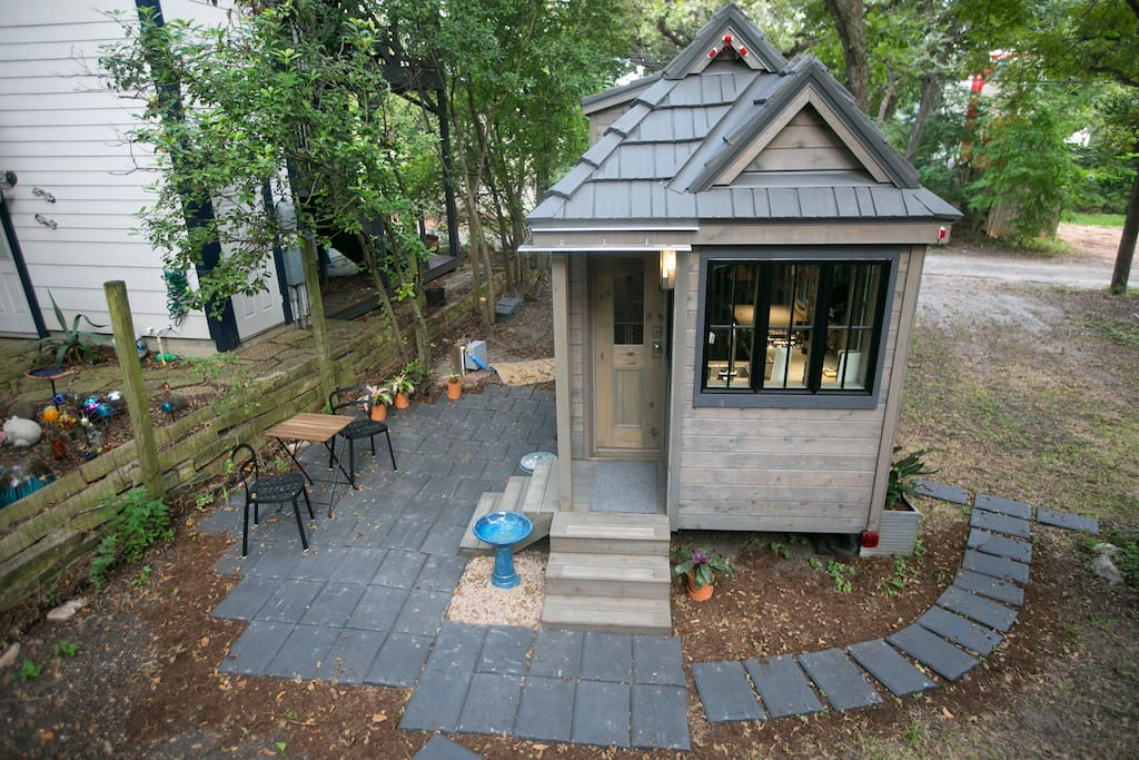 A small outdoor seating area adds to the living space in this urban oasis.