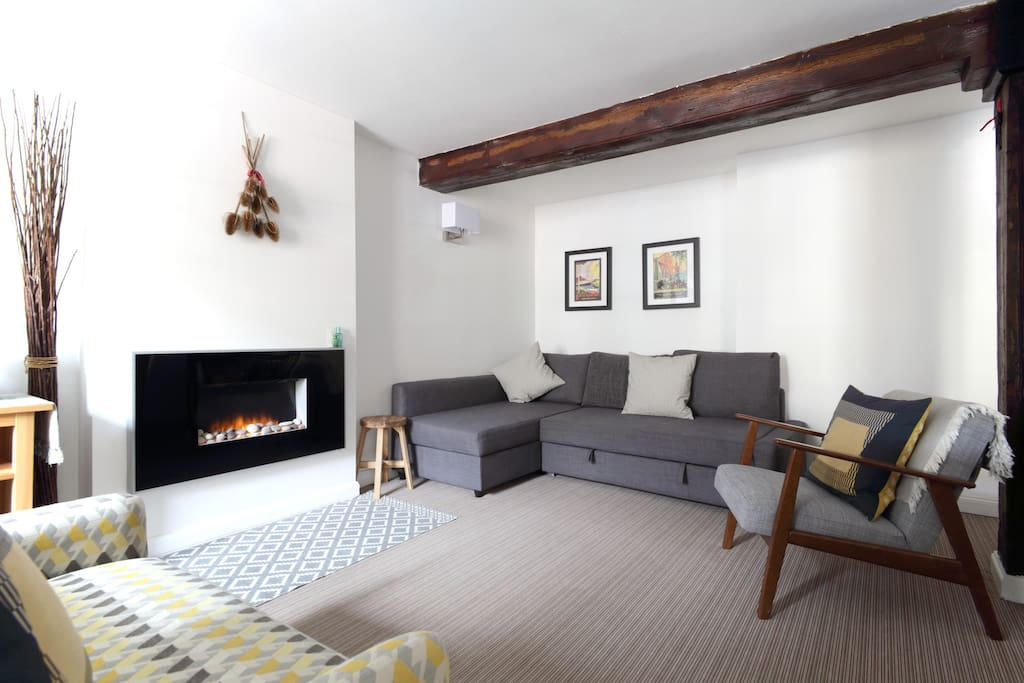Lounge with original beams and flame effect fire