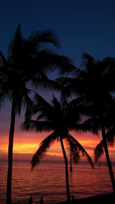 """Sunset from """"sunset grill"""" tiki hut restaurant with pool that we love"""