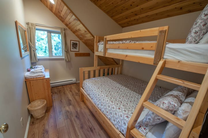 Bunk bed with double bed on bottom