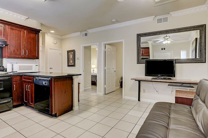 2 bedroom, 1Q 2T beds, lots of gated parking 77036
