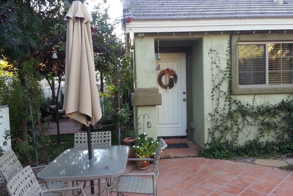 Side yard with private shaded sitting area