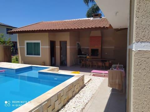 Casa agradável com piscina...