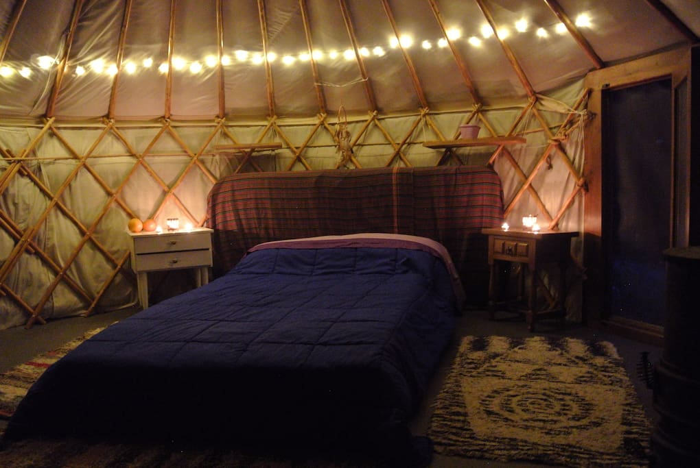 Lights inside the yurt.   More rugs are added in winter - as is fire wood.