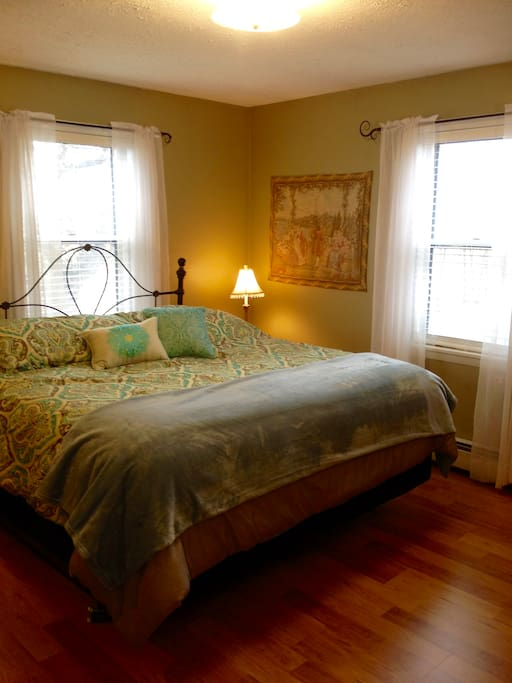 Main bedroom has two windows for natural light and fresh breezes.