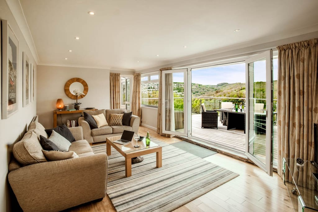 Open the French doors to let the sun in, curl up on the sofas to watch Netflix and Amazon Prime (all included), or sprawl out and play board games