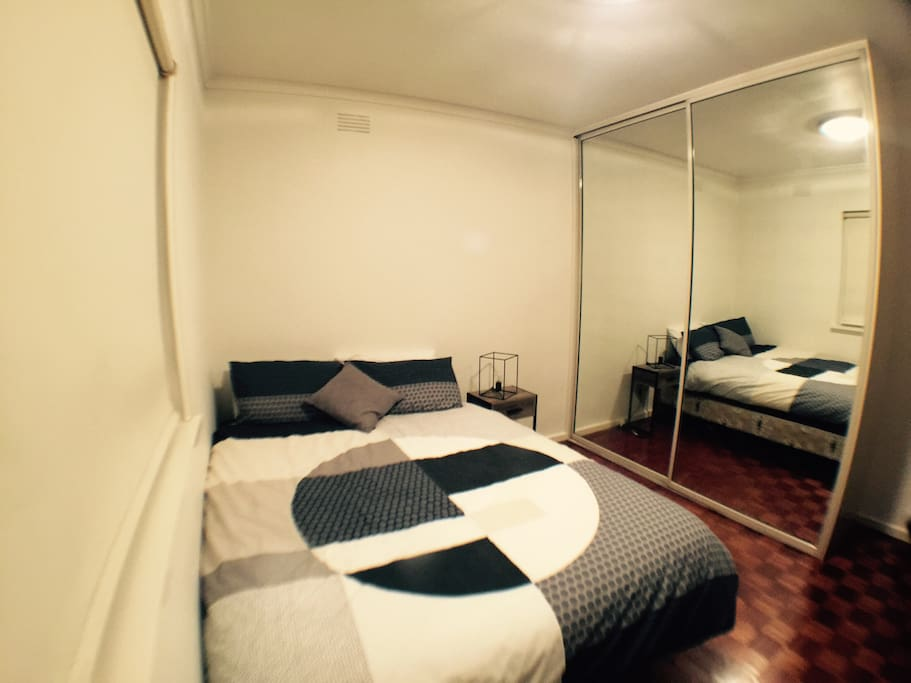Master bedroom with queen size bed with linen provided and TV with DVD player.