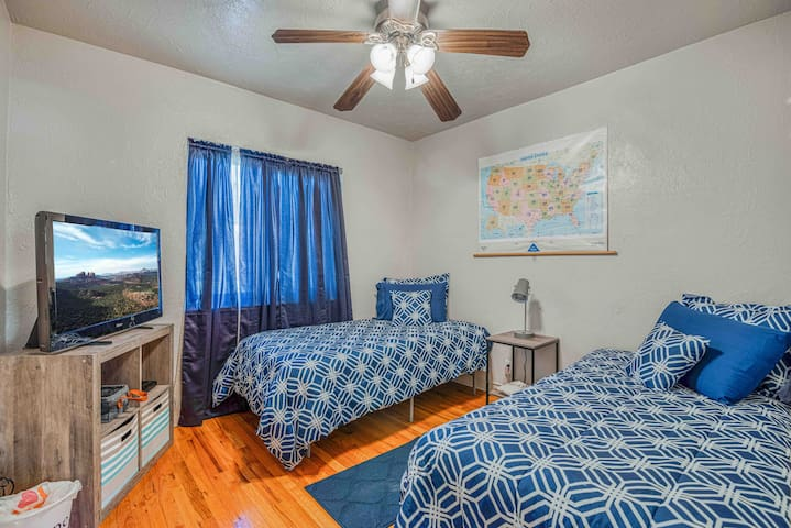Guest room has two twin beds and 42 inch tv with access to Roku and DVD player.