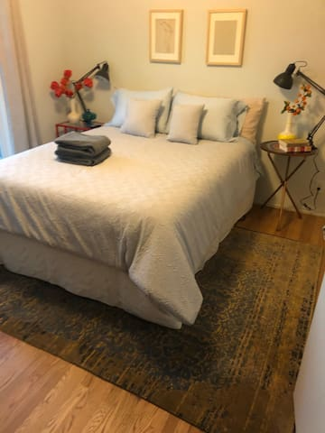 Luxuriate in organic linens on your adjustable queen bed. Create your custom sleeping comfort from upright to zero gravity position and drift off to gentle vibrations with remote control and automatic shut-off.  Extra blankets and pillows provided.