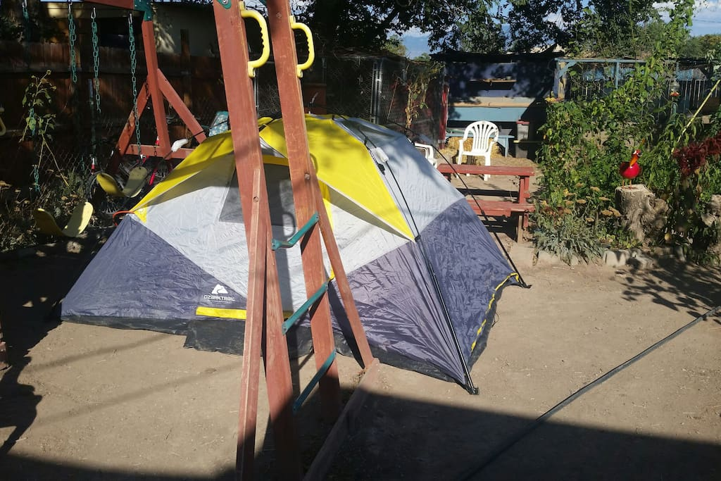 Camp site is in front of the swing set. (tent is not included unless you rent it)