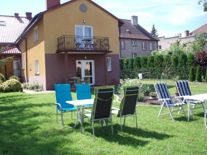 Ferienwohnung mit Terrasse in Darłowo