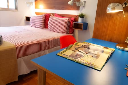 Air conditioned room with comfortable queen size bed with working space