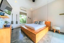 Queen sized bedroom with private ensuite on the second floor.  Has undercover balcony overlooking pool and gardens.