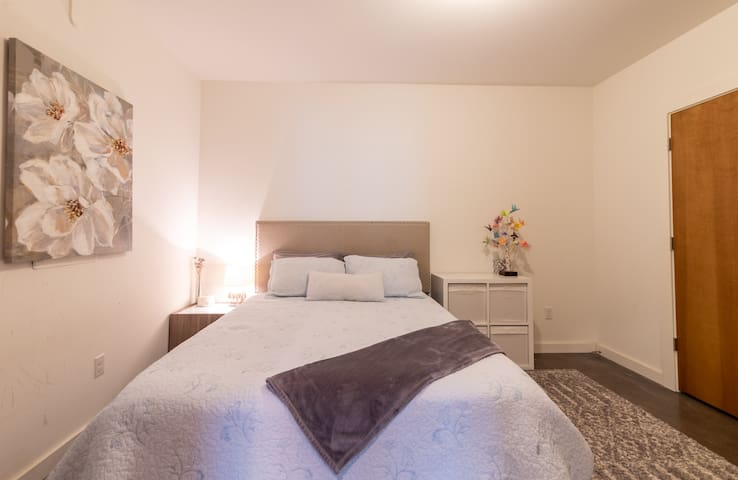 Your quiet and dark bedroom is perfect for resting after a long day of adventure! Features a queen bed with fresh linens, a large closet, and white noise machine (if you need it!)