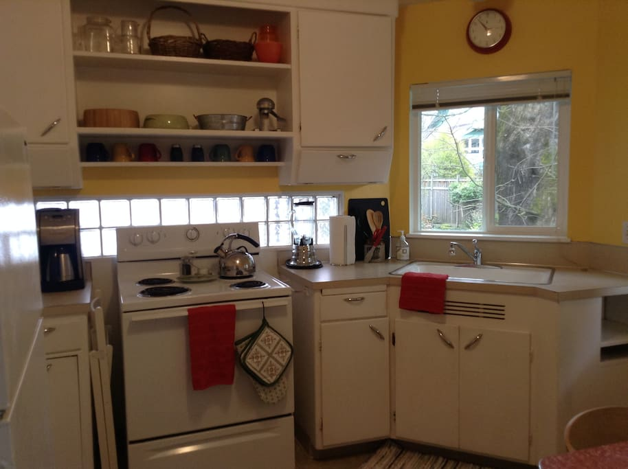 Sunny 1940s kitchen with retro charm.
