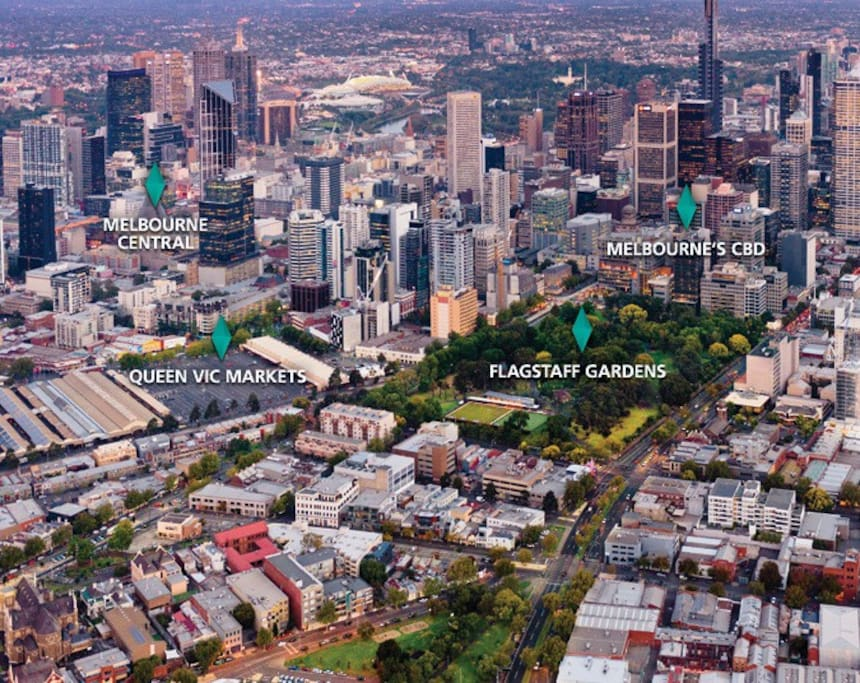 Eades Place Park (centre foreground) to Queen Vic market to Flagstaff to CBD then MCG, Tennis & AAMI stadiums.  Etihad to the right of photo
