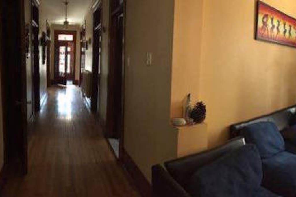 Big hallway ! Lovely masks and decor.