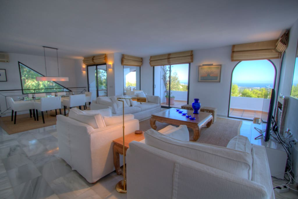 Ample and bright living room with sea views
