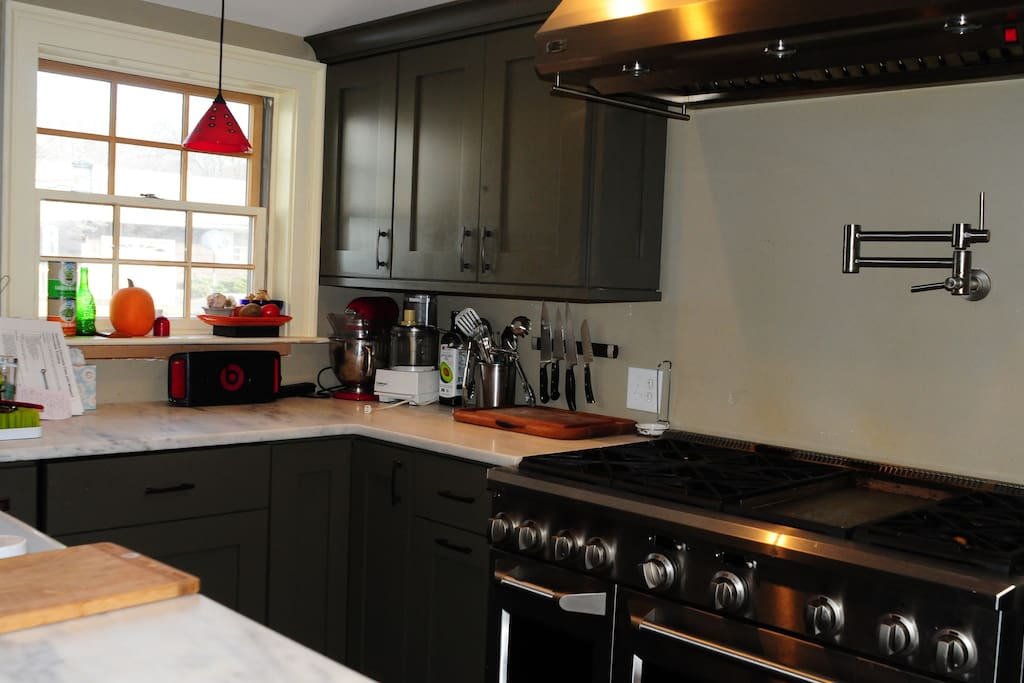 """Kitchen with a 48"""" stove with 2 ovens and plenty of room for cooking."""