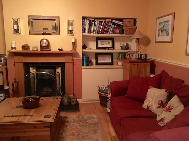 Guest sitting room, with real coal fire.