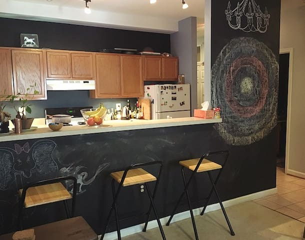 Breakfast bar and chalkboard wall, view from living room.