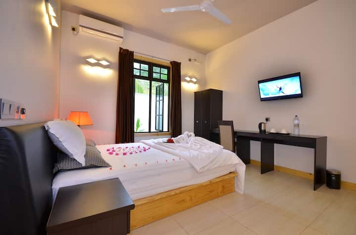Beach Residence Ukulhas a home step to the beach