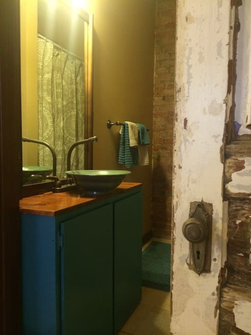 Bathroom, with a vessel sink potted by a local artist! Roomy standup shower.