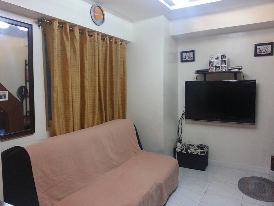 The living room with sofa bed and flat screen LCD TV.