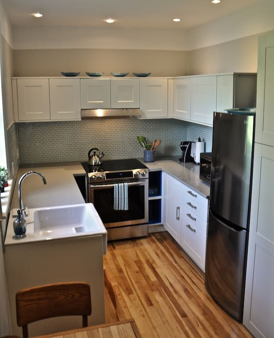 New kitchen with SS dishwasher ,microwave, oven and fridge