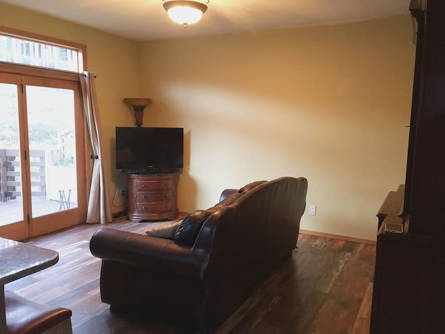 TV/living room continuous with kitchen.